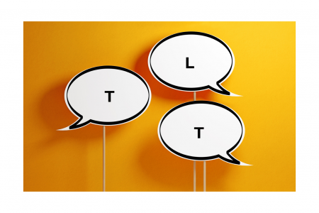 three speech bubbles on yellow background spelling TLT